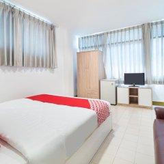 Апартаменты OYO 648 Ake Apartment Паттайя комната для гостей