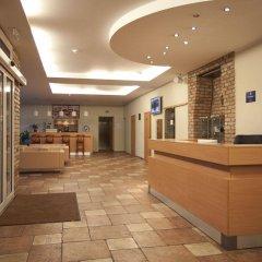 Отель Toss Hotel Латвия, Рига - 11 отзывов об отеле, цены и фото номеров - забронировать отель Toss Hotel онлайн интерьер отеля