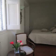 Апартаменты Sleep in Italy Oltrarno Apartments Флоренция комната для гостей