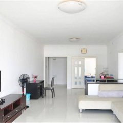 Апартаменты Sanya Haizhixing Seascape Holiday Apartment комната для гостей фото 2
