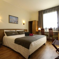Отель Tulip Inn Padova Падуя сейф в номере