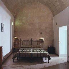 Отель SASSI Матера комната для гостей