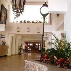 Отель Caleta Beach Resort Мексика, Акапулько - отзывы, цены и фото номеров - забронировать отель Caleta Beach Resort онлайн интерьер отеля