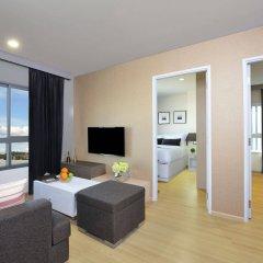 Отель The Grass Serviced Suites by At Mind комната для гостей фото 3