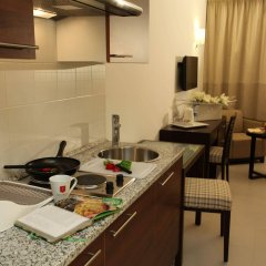 Le Corail Suites Hotel в номере