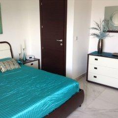 Апартаменты Luxury Seafront Apartment With Pool Каура сейф в номере