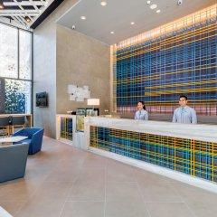 Отель Holiday Inn Express Bangkok Soi Soonvijai интерьер отеля
