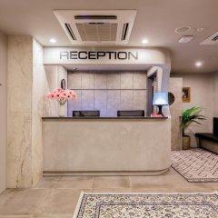 Circular House Capsule Hotel Сингапур интерьер отеля