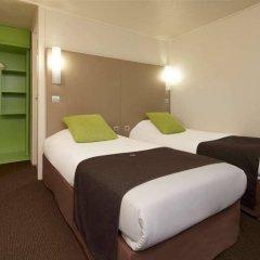 Отель Kyriad PARIS NORD - Ecouen La Croix Verte сейф в номере