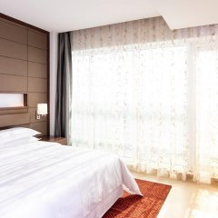 Отель Four Points by Sheraton Sharjah комната для гостей
