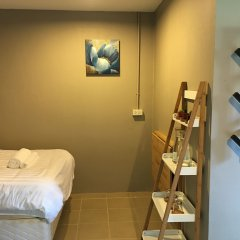 Отель Wanmai Herb Garden сейф в номере