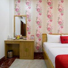 Отель RedDoorz Plus near Tan Son Nhat Airport 2 сейф в номере