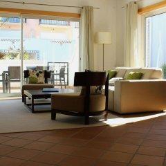 Отель The Village Praia D El Rey Golf & Beach Resort Обидуш интерьер отеля