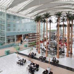 Отель Hilton Munich Airport Германия, Мюнхен - 7 отзывов об отеле, цены и фото номеров - забронировать отель Hilton Munich Airport онлайн фитнесс-зал фото 4
