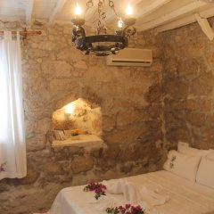 Отель Alacati Asmali Konak Otel Чешме комната для гостей