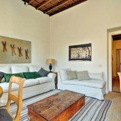 Апартаменты Trevi Stylish Apartment Рим комната для гостей фото 3