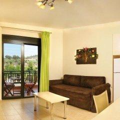 Апартаменты Avra Apartments Ситония комната для гостей
