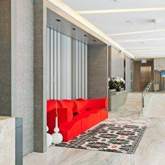 Отель Louis Kienne Serviced Residences интерьер отеля