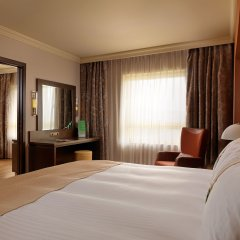 Отель Holiday Inn Attica Av. Airport West Спата комната для гостей фото 5