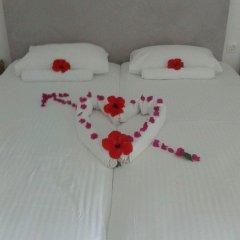 Отель Okeanis Beach сейф в номере