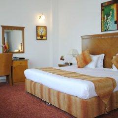 Ramee Guestline Hotel комната для гостей