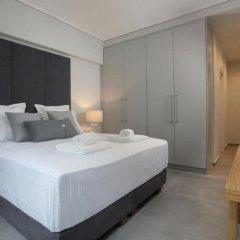 Апартаменты LeGeo-Luxurious Athenian Apartment комната для гостей фото 3