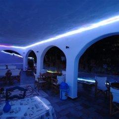 Hotel Psarou Beach гостиничный бар