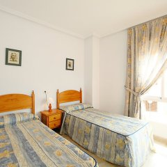 Отель Las Calitas Bloque III Ориуэла комната для гостей фото 5