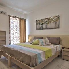 Апартаменты First Class Apartments Calleja by G&G комната для гостей
