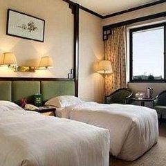 Отель Xian Dynasty Hotel Китай, Сиань - отзывы, цены и фото номеров - забронировать отель Xian Dynasty Hotel онлайн комната для гостей