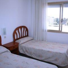 Отель Suite Apartments Arquus Испания, Салоу - отзывы, цены и фото номеров - забронировать отель Suite Apartments Arquus онлайн комната для гостей