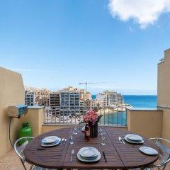Отель Morina Penthouse Мальта, Сан Джулианс - отзывы, цены и фото номеров - забронировать отель Morina Penthouse онлайн балкон