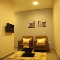 Отель Kiniz Luxury Apartments Нигерия, Уйо - отзывы, цены и фото номеров - забронировать отель Kiniz Luxury Apartments онлайн комната для гостей фото 3
