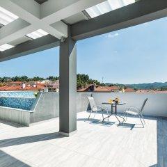 Отель Nymphes Deluxe Accommodation Греция, Пефкохори - отзывы, цены и фото номеров - забронировать отель Nymphes Deluxe Accommodation онлайн бассейн фото 3