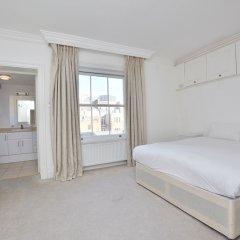 Апартаменты 15 Beaufort Gardens Apartments Лондон комната для гостей фото 3