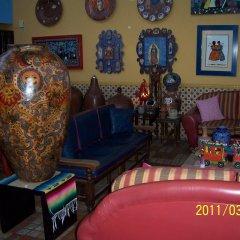 Отель Casa de las Flores Мексика, Тлакуепакуе - отзывы, цены и фото номеров - забронировать отель Casa de las Flores онлайн гостиничный бар