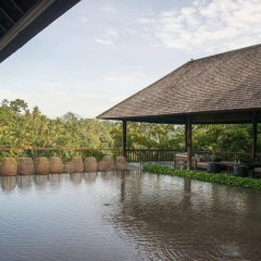 Отель Komaneka at Bisma бассейн