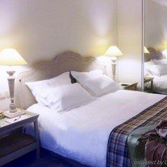 Отель Royal Hotel Paris Champs Elysées Франция, Париж - отзывы, цены и фото номеров - забронировать отель Royal Hotel Paris Champs Elysées онлайн комната для гостей