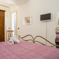 Отель Deluxe Apartment in Villa Pantarei Италия, Поццалло - отзывы, цены и фото номеров - забронировать отель Deluxe Apartment in Villa Pantarei онлайн комната для гостей фото 3