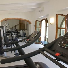 Villa Tolomei Hotel & Resort Флоренция фитнесс-зал