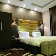 Отель Golden Tulip Essential Benin City комната для гостей фото 3