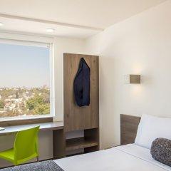 Отель One Guadalajara Expo комната для гостей
