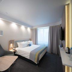 Отель Holiday Inn Express Moscow Baumanskaya Москва комната для гостей фото 4