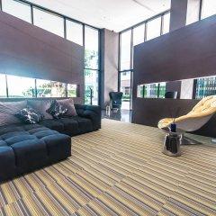 Отель Central Pattaya Residence (At The Base Condo) Паттайя комната для гостей