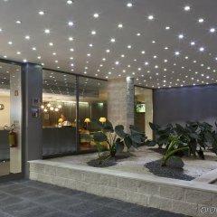 Отель Holiday Inn Express Lisbon Airport Португалия, Лиссабон - 3 отзыва об отеле, цены и фото номеров - забронировать отель Holiday Inn Express Lisbon Airport онлайн интерьер отеля фото 3