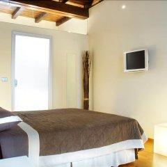 Отель Terres d'Aventure Suites Италия, Турин - отзывы, цены и фото номеров - забронировать отель Terres d'Aventure Suites онлайн комната для гостей фото 3