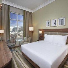 Отель Hilton Garden Inn Dubai Al Muraqabat Дубай комната для гостей