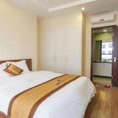 Апартаменты Bayhomes Times City Serviced Apartment комната для гостей фото 4