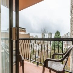 Отель Sunset Inn and Suites Канада, Ванкувер - отзывы, цены и фото номеров - забронировать отель Sunset Inn and Suites онлайн балкон