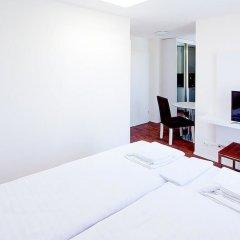 Апартаменты Suite Apartments By Livingdowntown Цюрих комната для гостей фото 3